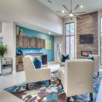 Living room seating area at Bradford Point multi-family interior design project