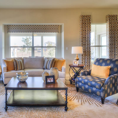 Tan and blue living room design at Blanco Vista in Austin, Texas