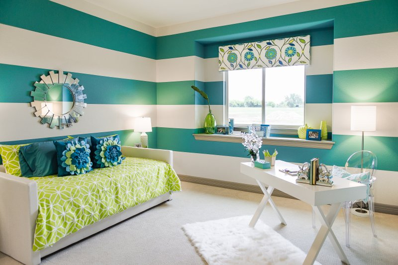 Blue and green girl's bedroom interior design for model home in Liberty Hill, TX