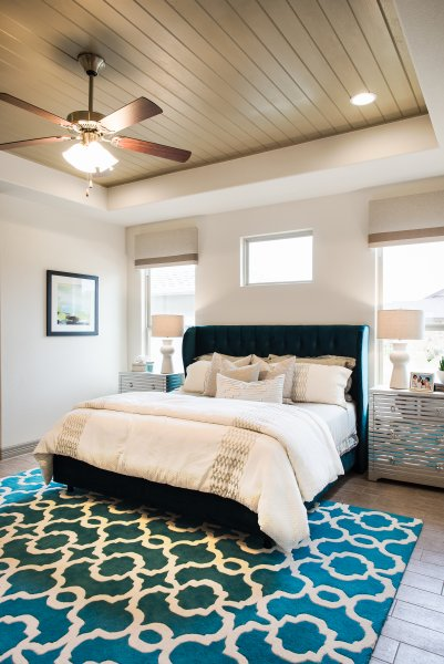 Professional master bedroom design for Rio Ancho model home in Liberty Hill, TX