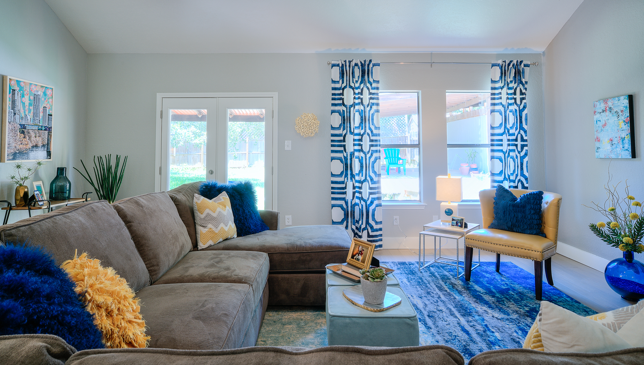 Professionally designed sitting room with blue and yellow accents in Austin, Texas