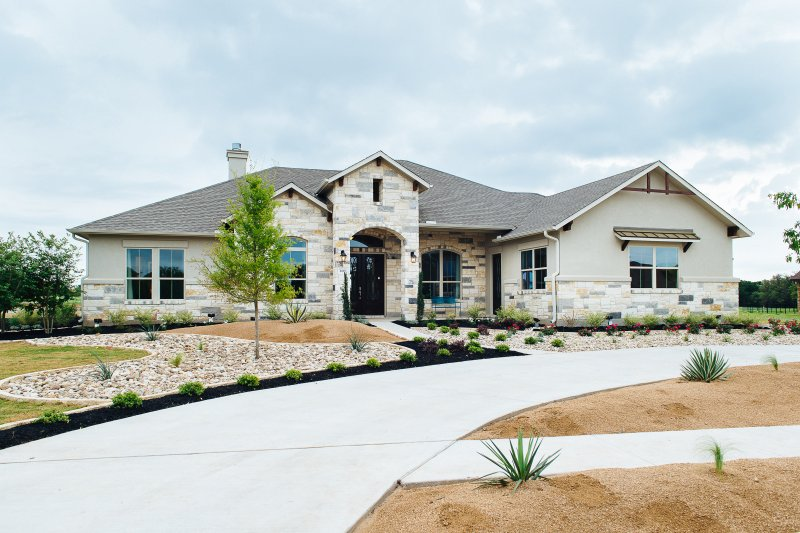 Rio Ancho model home exterior by Michelle Thomas Design in Liberty Hill, Texas