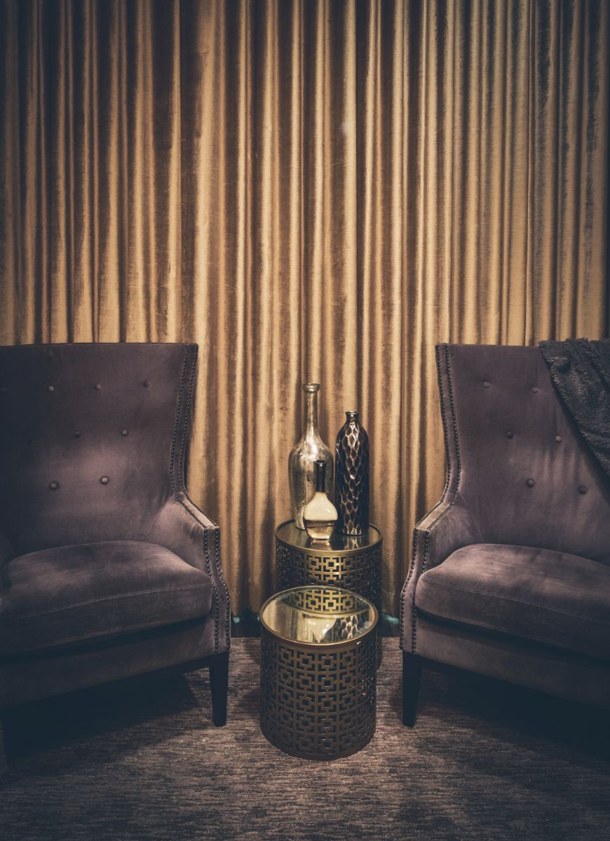 Dark brown chairs in seating area at Massage Sway in Austin, Texas
