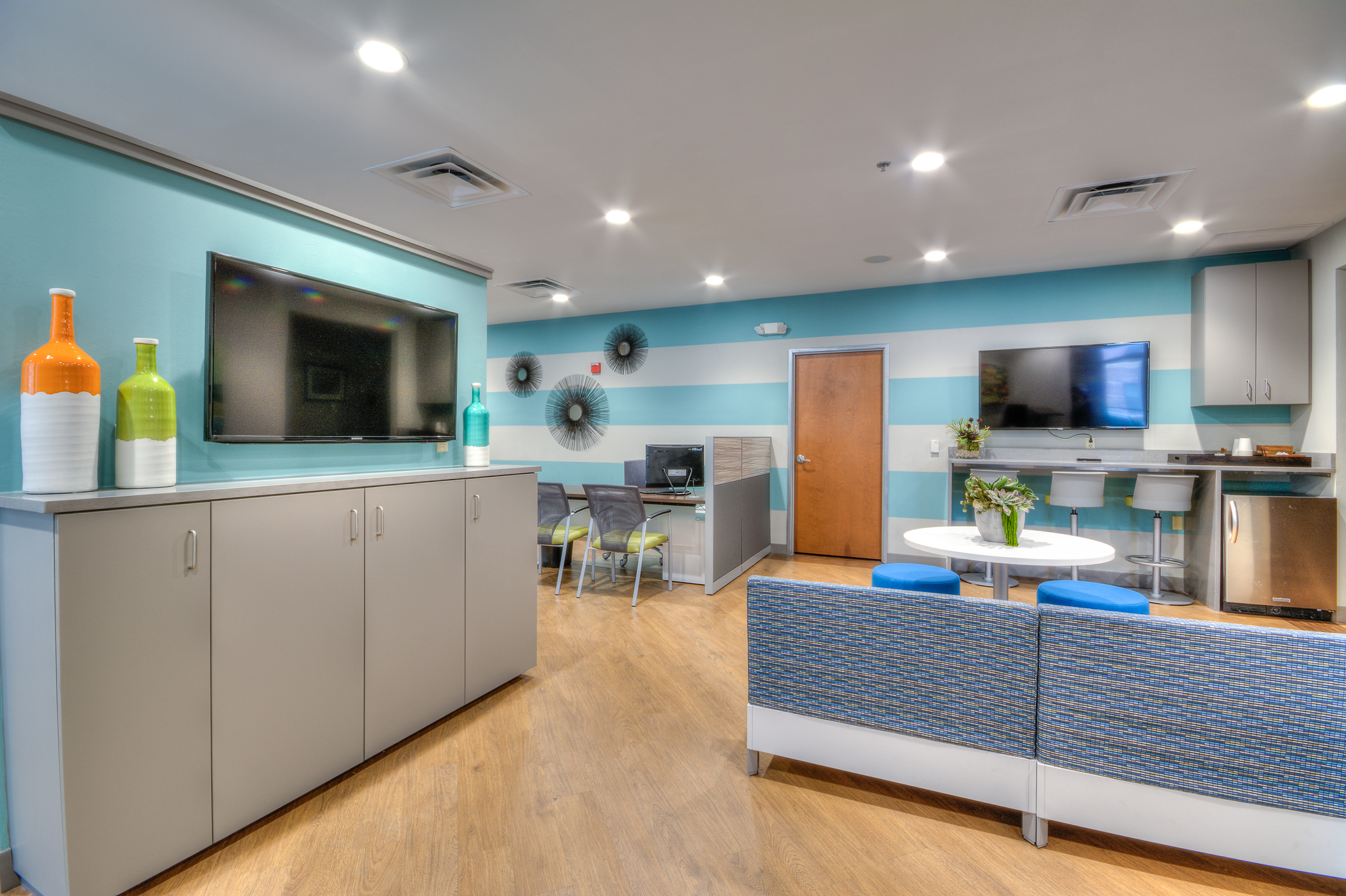Interior design for the Quarters on Campus leasing office in Austin, Texas