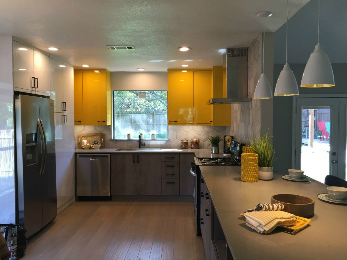 Yellow kitchen cabinets used in Laura and Steve's home renovation